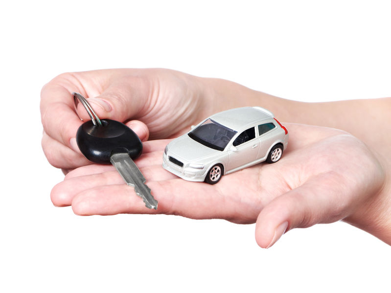 41961273 - hand with keys and car on white background