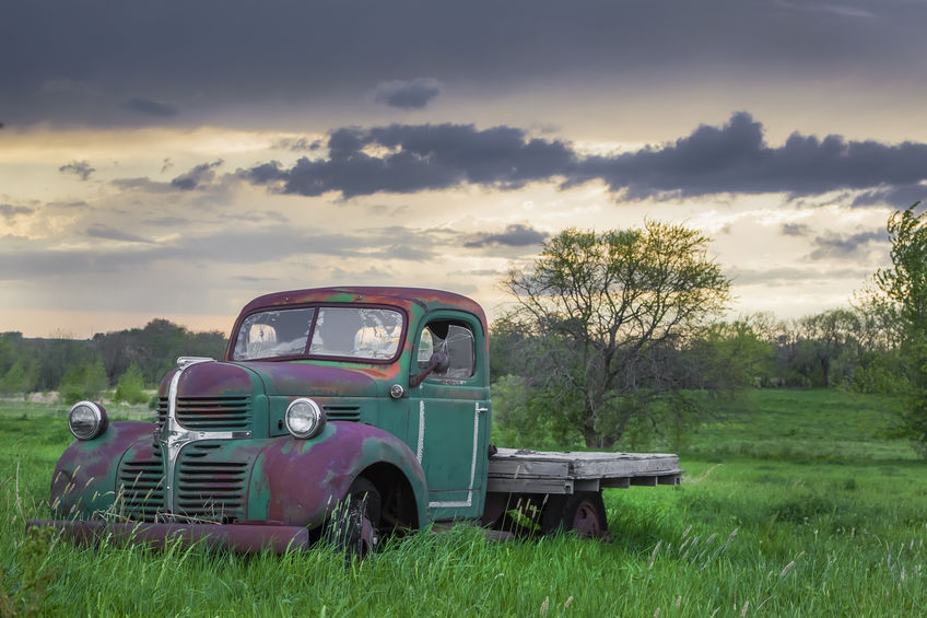 Abandoned car in a midwestern field